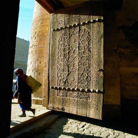 GATES OF KUNJA-ARK PALACE Ichan-Kala inner city of Khiva Uzbekistan XVIII-XIX centuries Carved wooden gate of the palace of the Khans of Khiva